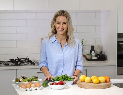Natalie Brady in the kitchen with healthy food on the bench